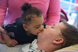 Cayla Wilson gets a kiss from her daughter.
